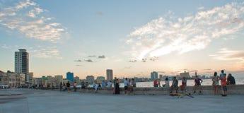 HAVANA, CUBA - OCTOBER 22, 2016. People sitting on Havana bay pr Stock Photos