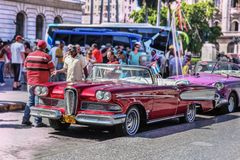 Havana / Cuba - 07/2018: Old and rusty vintage american cars of 1950s taxi in Havana. Red Edsel Pacer on the front position, the royalty free stock photography
