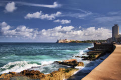 Havana. Cuba seafront with waves crashing against the sea wall in front of the Malecon road stock images