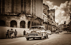 Havana, Cuba - September 14, 2016: American classic car drives on the main street with street life view in Havana Cuba - Retro Ser. American classic car drives Stock Image