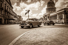 Havana, Cuba - September 14, 2016: American Mercury and a Buick classic car on the crossroad before the Capitolio in Havana Cuba -. American Mercury and a Buick Royalty Free Stock Image