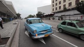 Havana, Cuba. Traffic in Havana, in Havana Central district, old American car next to old communist car green one produced in Poland during communist time under