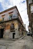 Havana eroded building facade. Corner with eroded building facade against blue sky in San ignacio street, Havana, cuba royalty free stock images