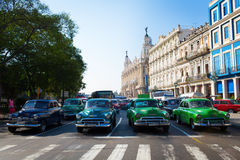 HAVANA - FEBRUARY 17: Classic car and antique buildings on Febru Stock Photos