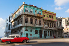HAVANA - FEBRUARY 17: Classic car and antique buildings on Febru Stock Photography