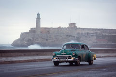 HAVANA - FEBRUARY 18: Classic car and antique buildings on Febru Royalty Free Stock Photo