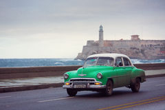 HAVANA - FEBRUARY 18: Classic car and antique buildings on Febru Stock Images