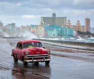 HAVANA - FEBRUARY 19: Classic car and antique buildings on Febru Stock Images
