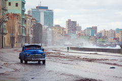 HAVANA - FEBRUARY 19: Classic car and antique buildings on Febru Stock Photography