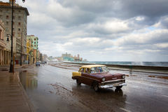 HAVANA - FEBRUARY 19: Classic car and antique buildings on Febru Royalty Free Stock Photo