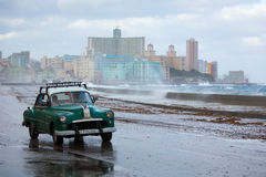 HAVANA - FEBRUARY 19: Classic car and antique buildings on Febru Royalty Free Stock Image