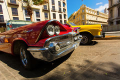 HAVANA - FEBRUARY 26: Classic car and antique buildings on Febru Stock Photo