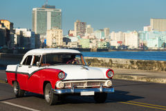 HAVANA - FEBRUARY 26: Classic car and antique buildings on Febru Stock Photos