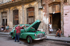 HAVANA - FEBRUARY 25: Classic car and antique buildings on February 25, 2015 in Havana. These vintage cars are an iconic sight of Stock Photos