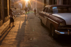 HAVANA - FEBRUARY 25: Classic car and antique buildings on February 25, 2015 in Havana. These vintage cars are an iconic sight of Stock Photography