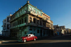 HAVANA - FEBRUARY 25: Classic car and antique buildings on February 25, 2015 in Havana. These vintage cars are an iconic sight of Stock Image