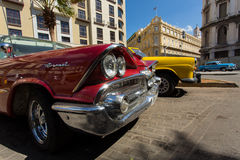 HAVANA - FEBRUARY 25: Classic car and antique buildings on February 25, 2015 in Havana. These vintage cars are an iconic sight of Stock Photo