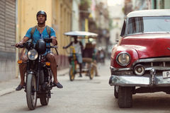 HAVANA - FEBRUARY 25: Classic car and antique buildings on February 25, 2015 in Havana. These vintage cars are an iconic sight of Royalty Free Stock Images