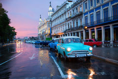 HAVANA - FEBRUARY 18: Classic car and antique buildings on FebruClassic old car on streets of Havana, Cuba. Royalty Free Stock Images