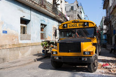 HAVANA - FEBRUARY 17: Classic school bus on streets of Havana onClassic old car on streets of Havana, Cuba. Classic old car on streets of Havana, Cuba Stock Images