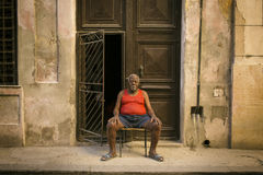 HAVANA - FEBRUARY 17: Unkown woman staying on front of her house on February 17, 2015 in Havana. Havana is the capital city, provi Stock Photography