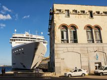 Havana harbor terminal with huge cruise ship moored. Havana, Cuba - December 3, 2017: Havana harbor terminal with huge cruise ship moored Royalty Free Stock Image