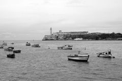 Havana Harbor. A view of fishing boats and the Castillo de los Tres Reyes across the harbor of Havana, Cuba Stock Images