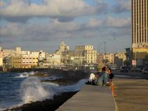 Havana Malecon. Waves break against the Havana Malecon stock images