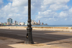 Havana Malecon is a broad esplanade  along the coast in Havana. Havana Malecon. The Malecon officially Avenida de Maceo is a broad esplanade, roadway and seawall Stock Images