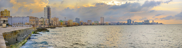 Havana Malecon Panorama. Panoramic view of Havana bay and city skyline along the waterfront (malecon) at sunset Royalty Free Stock Image