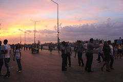 Havana Malecon and people at sunset. People crossing the street in Havana Malecon Stock Photo