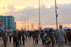 Havana Malecon at sunset. People crossing the street in Havana Malecon Stock Image