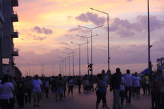 Havana Malecon at sunset. People crossing the street in front of Havana Malecon Stock Photos