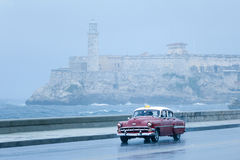 Havana malecon taxi. Havana malecon collective  taxi at the stormy day Stock Images