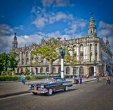 Havana old car by capitol buildings. An old american car outside the capitolio nacional building in havana cuba Royalty Free Stock Photography
