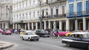 HAVANA, CUBA - OCTOBER 20, 2017: Havana Old Town with Tourist. Old Vehicles and People stock video footage