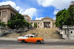 Havana´s university. Havana´s university with orange vintage car Royalty Free Stock Photos