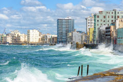 The Havana skyline with big waves on the sea. The Havana skyline with big sea waves crashing on the Malecon seawall Royalty Free Stock Photography