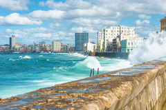 The Havana skyline with big waves on the sea. The Havana skyline with big sea waves crashing on the Malecon seawall Royalty Free Stock Images