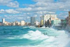 The Havana skyline with big waves on the sea. The Havana skyline with big sea waves crashing on the Malecon seawall Royalty Free Stock Photos