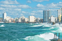 The Havana skyline with big waves on the sea. The Havana skyline with big sea waves crashing on the Malecon seawall Royalty Free Stock Photo