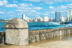 The Havana skyline and the famous Malecon seawall. The Havana skyline with big sea waves crashing on the Malecon seawall Royalty Free Stock Photography