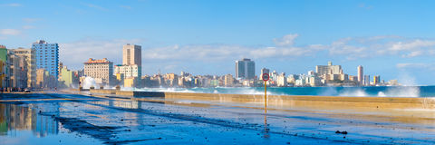 The Havana skyline with sea waves crashing on the Malecon seawall Royalty Free Stock Photography