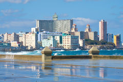 The Havana skyline with waves crashing on the Malecon. Seawall Royalty Free Stock Images