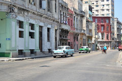 Havana street cars. Havana, Cuba - July, 18: classic American cars in downtown Havana in Cuba on July 18, 2014. The cars area a major tourist attraction to the Stock Photo