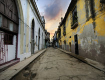 Havana street with eroded buildings Royalty Free Stock Images