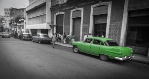 Havana street scene in monochrome old dilapidated buildings, peo Stock Photography