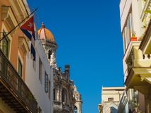 Havana streets with bright colours and cuban flags royalty free stock image