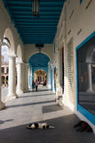 Havana - under the arcades of the old town, plaza Vieja. Havana, Cuba - February 17, 2015: under the arcades of the old town, plaza Vieja. The square is Royalty Free Stock Image