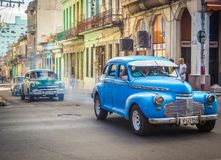 Havana vieja with vintage cars. The streets of Havana vieja with colorfu vintage cars Stock Photo